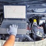Professional car mechanic working in auto repair c...