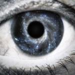 Постер, плакат: Human eye looking in Universe
