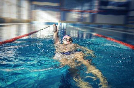 Swimmer swimming backstroke