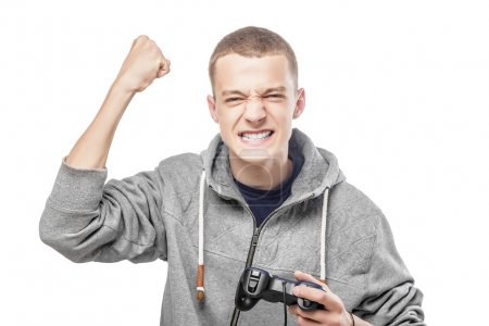 Photo for Young man with a joystick for game console celebrating success. Isolated on white. - Royalty Free Image