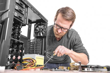 Photo for Computer repair. Computer technician working on a personal computer - Royalty Free Image