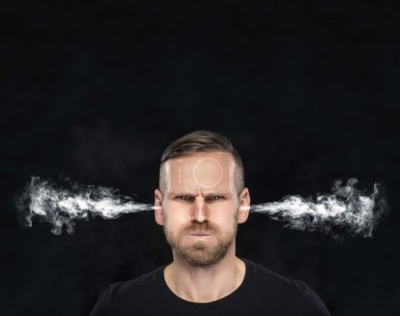 Angry man with smoke or fume coming out from his e...