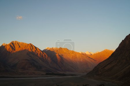Sunset over Himalayas mountains in Nubra valley , Northern India