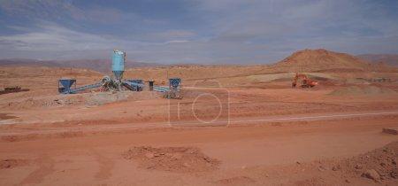 Sahara desert construction site with bulldozer,Morocco