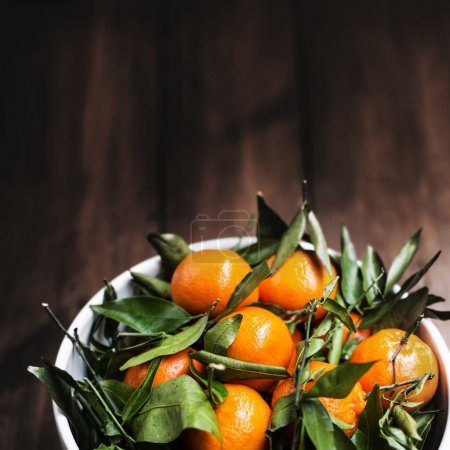 Tangerines  clementines on old wooden table...