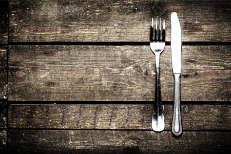 Photo for Silver Knife and fork over wooden table with copy space. Diet Food concept. - Royalty Free Image