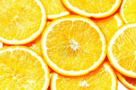 Photo for Orange Background. Slices of fresh orange fruit closeup. Healthy food. background. - Royalty Free Image