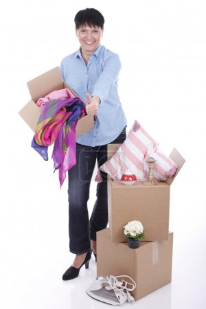 Elderly woman with moving boxes