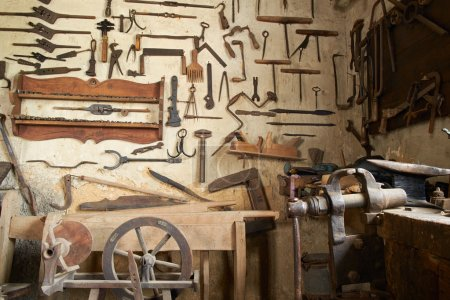 Wall with tools for horseshoes
