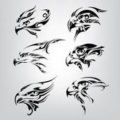 Silhouette of  heads of birds