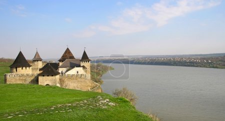 The picturesque medieval castle on the river bank