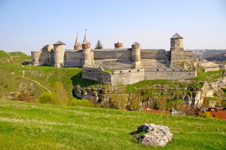 Fairy medieval castle amid the scenic green hills of eastern Eur