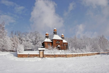 Russian Orthodox Church in the snow, with three crosses on the d