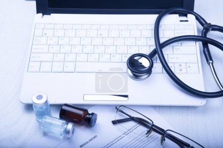 medical devices on the table at the doctor with blue toned