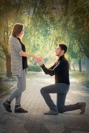 Photo for Man proposing marriage with a romantic gesture - Royalty Free Image