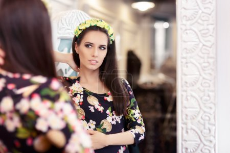 Photo for Portrait of a young woman in a dressing room with a flower pattern dress - Royalty Free Image