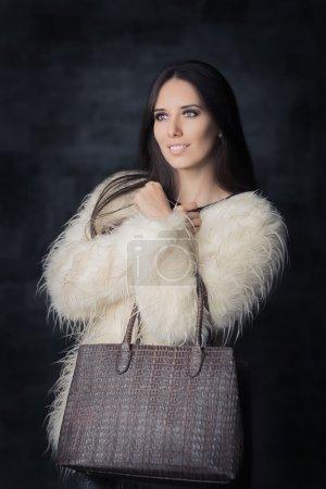 Beautiful Winter Woman in Fur Coat with Bag