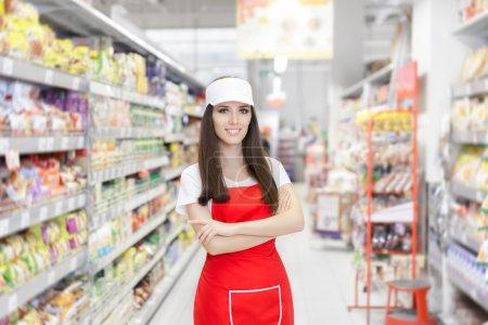 Smiling Supermarket Employee Standing Among Shelves
