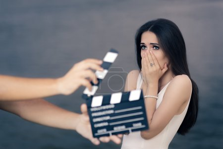 Photo for Young professional cinema star acting sad in a drama film - Royalty Free Image