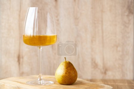 Amber or white wine with fruit. Poured glass with ...