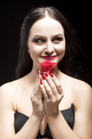 Portrait of Sexy and Sensual Brunette Woman Posing With red Flower in Studio
