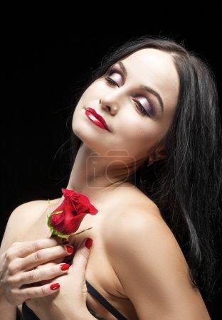Portrait of Sensual Vulnerable Caucasian Brunette Woman Posing With Rose Flower