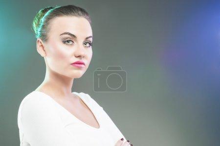 Portrait of Serious Brunette Woman Over Gray Backg...
