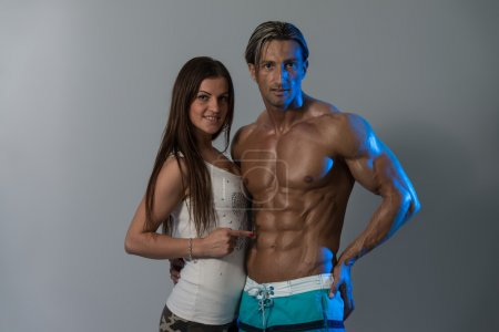 Sexy Couple Seductively Flaunting Perfect Abs