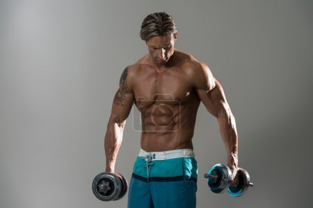 Muscular Man Athlete Standing And Looking Down