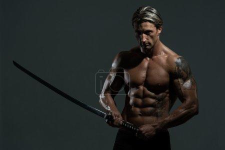 Mature Man Holding Warrior Sword