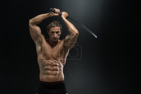 Mature Man In Action With Sword