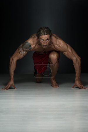 Middle Age Man Exercising In Studio Push Ups