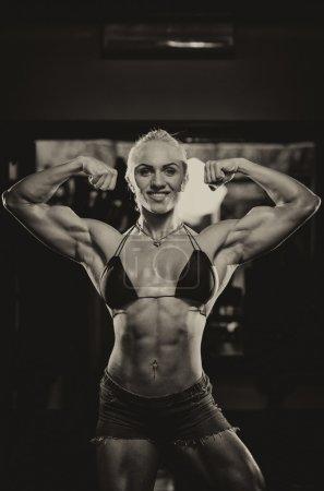 Female Bodybuilder Flexing Muscles