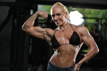 Woman Bodybuilder Flexing Muscles
