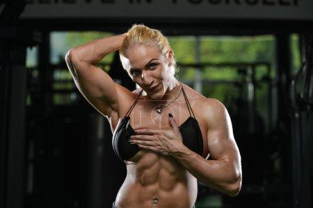 Female Bodybuilder Showing Abs