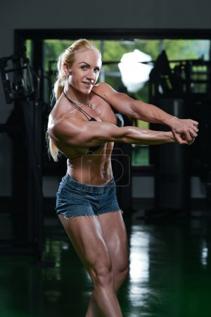 Female Bodybuilder Flexing Muscles