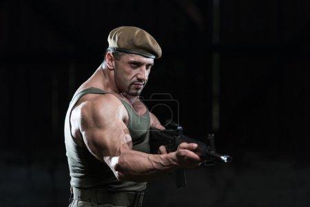 Soldier Aims Machine Gun