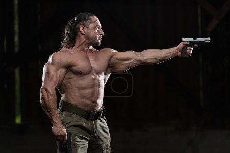 Soldier Aims A Gun
