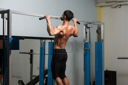 Male Fitness Athlete Doing Heavy Weight Exercise F...