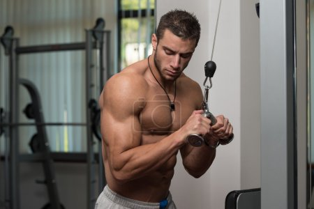 Photo for Young Athlete Doing Heavy Weight Exercise For Triceps - Royalty Free Image
