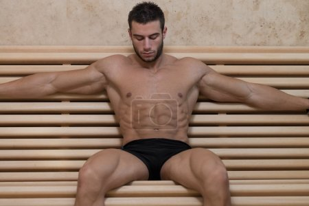 Photo for Happy Good Looking And Attractive Young Man With Muscular Body Relaxing In Sauna Hot - Royalty Free Image