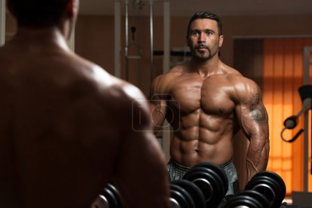 Photo for Latin Bodybuilder Working Out Biceps - Dumbbell Concentration Curls - Royalty Free Image