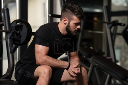 Photo for Portrait Of A Physically Fit Young Man Resting In A Health Modern Club - Royalty Free Image