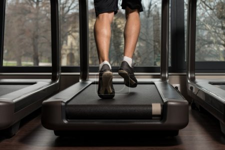 Man Feet On Treadmill