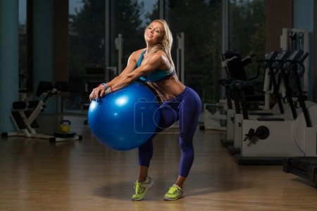 Mature Woman Working Out With An Exercise Ball