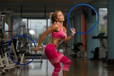 Attractive Woman Playing Around With Hula Hoop Rings