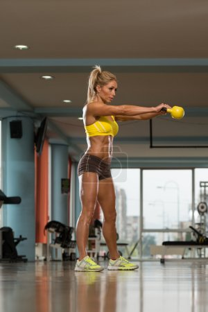 Fit Woman Working Out With A Kettle Bell