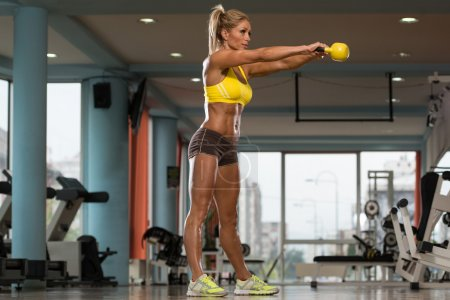 Middle Age Womane Exercise With KettleBell