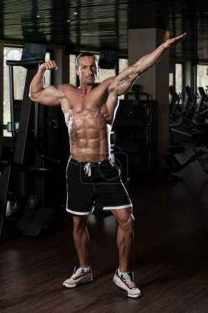 Photo for Portrait Of A Physically Fit Man In Modern Fitness Center - Royalty Free Image
