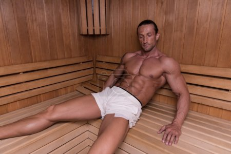 Photo for Good Looking And Attractive Mature Man With Muscular Body Relaxing In Sauna Hot - Royalty Free Image